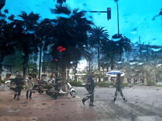 Photo from my parked car. Rainy Day Rain On My Car Rain On Glass Rain Drops Rain In The City Rain Umbrella Umbrellas Blur Rain Blur The Street Photographer - 2016 EyeEm Awards