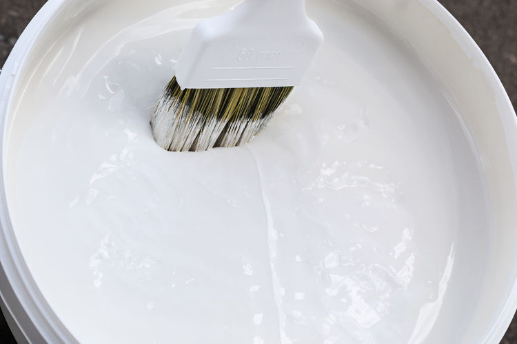 White Paint Can With Brush