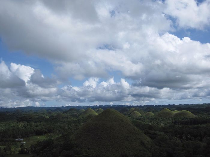 Bohol Island Bohol, Philippines Cebu,Philippine Cebu セブ島 ボホール島 チョコレートヒルズ Chocolate Hills Chocolate Hills Bohol Philippines Landscape Sky Scenics Field Nature Tranquility Agriculture Tranquil Scene Beauty In Nature Rural Scene No People Green Color Tree Growth Day Mountain