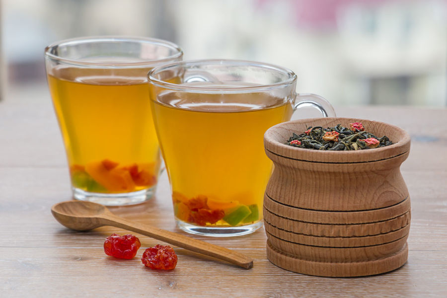 green tea and dried fruits on a wooden surface Cup Glass Beverage Breakfast Detox Rustic Slim Tea Thirst Antioxidant Background Berry Blurred Background Blurry Dehydration Drink Dry Drying Fruits Fruit Green Tea Leaf Morning Rituals Rejuvenation Slimming Vegan Vitamin Wooden Berry Fruit Mint Tea Dried