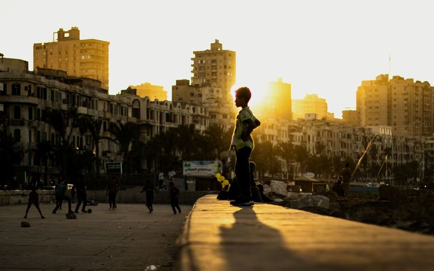 Golden Boy Everydayeverywhere Medailylife Checkoutegypt Streetleaks  Spjstreets Streetphotography Everybodystreet Everybodystreet Streetphotography Lensonstreets Minimalha Sun The Great Outdoors - 2018 EyeEm Awards City Cityscape Men Sunset Full Length Standing Silhouette Police Force Urban Skyline Sky Skyscraper Office Building Spire  Tall - High Television Tower Streaming Tower Politics And Government Communications Tower Downtown District Visiting Downtown City Location The Street Photographer - 2018 EyeEm Awards
