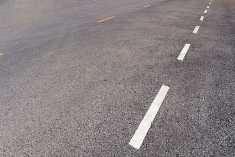 Arrow Symbol Asphalt Choice City Communication Day Direction Dividing Line Guidance High Angle View Marking No People Outdoors Road Road Marking Sign Street Symbol The Way Forward Transportation White Color