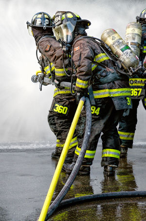 Approaching the Flame Close-up Day Fire Fighters Fire Suppression Focus On Foreground Lifestyles Nature Outdoors Sky Team Work Tourism Water Yellow