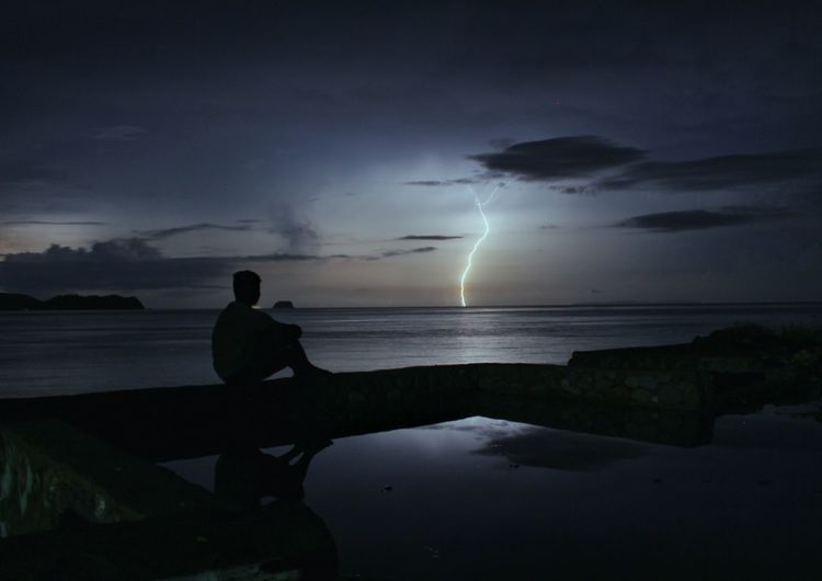 Me and the Lightning Night Silhouette Storm Lightning Thunderstorm Landscape Beauty In Nature Sea Water Storm Cloud One Man Only One Person EyeEmNewHere EyeemPhilippines Eyeemph