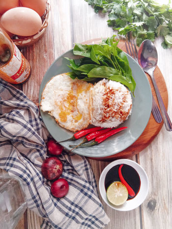 lunch Foodstyling Onion Egg Malaysian Food Soy Sauce Chillies Red Rice Plate Table Directly Above Close-up Food And Drink Eggshell Omelet Scrambled Eggs Fried Egg Egg Carton Egg Yolk Boiled Egg Poached Served Spoon Prepared Food