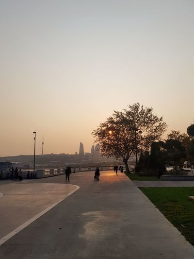 Feel the cold with orange Flametowers Baku Azerbaijan Sunshine ☀ Sunshine Park Caucasus Boulevard Bakubulevard Sky October Cold Orange Sun City Sunset Silhouette Full Length Outdoors Tree Sky People Beauty In Nature City Bird Day The Great Outdoors - 2018 EyeEm Awards