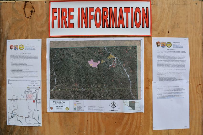 Posted information on Cowbell fire burning along Alligator Alley I-75 ( about 1 mile north) in Big Cypress National Preserve, Sunday April 9, 2017. One of 100 wildfires burning in Florida, this grew to 7,000 acres on this single day. Text Outdoors Close-up No People Wildfire Wildfires Roadside Big Cypress National Preserve Alligator Alley Interstate 75 Big Cypress Roadside America Florida Roadtrip Text Communication Update
