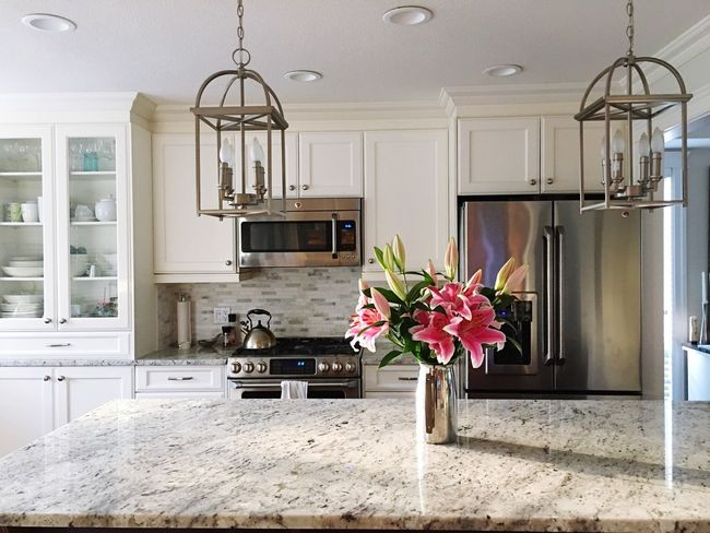 Monday mornings are easier when the kitchen is filled with sun rays and star gazer Lilly's. Home Interior Domestic Kitchen Indoors  Flower Domestic Room No People Home Showcase Interior Vase Day Cabinet