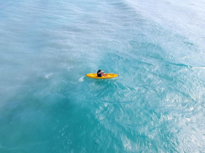 High angle view of man kayaking in sea