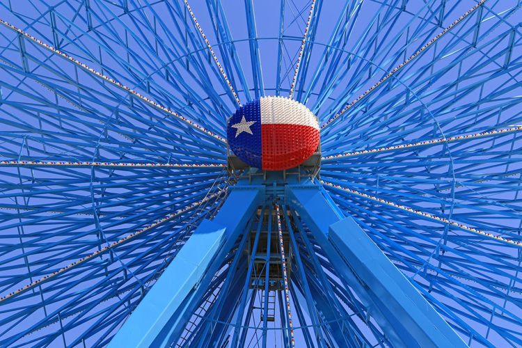 Detail of Ferris Wheel at the State Fair of Texas Dallas Texas Ferris Wheel Tickets Amusement Park Amusement Park Ride Annual Event Architecture Arts Culture And Entertainment Blue Blue Sky Built Structure Day Directly Below Ferris Wheel Low Angle View Metal Modern No People Outdoors Pattern Red Seasonal Sky Star State Fair Of Texas