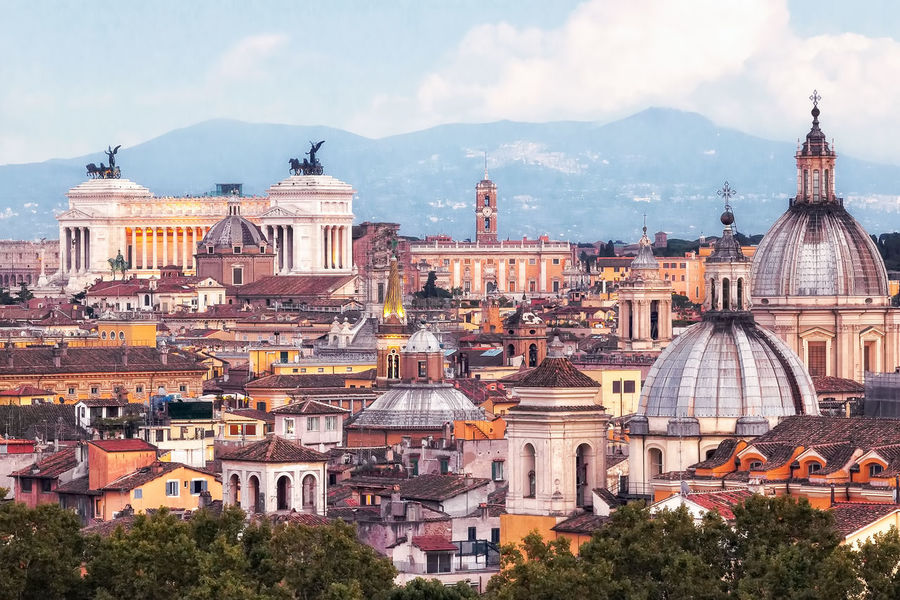 Panorama of Rome center. In the right foreground the dome of the church of San Salvatore in Lauria, in the middle dome of Santa Maria Peace. In the background the monumental Vittoriano and the Capitol Building, the seat of the municipality of Rome. Architecture Bell Tower Building Exterior Built Structure Campidoglio Center Churches City Cityscape Cityscapes Cloud - Sky Day Dome Horizon Line No People Outdoors Panorama View Rome, Italy Sky Sunset The City Light