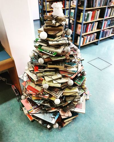 Stack Large Group Of Objects Arrangement Books Book Christmas Tree Books Indoors  Bookshelf Christmas Tree Christmastime Christmas Decoration