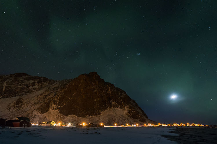 Astronomy Aurora Borealis Aurora Polaris Beauty In Nature Cold Temperature Darkness And Light Dramatic Sky Galaxy Lofoten Milky Way Moon Mountain Natural Phenomenon Nature Night Nightphotography The Great Outdoors - 2017 EyeEm Awards Northern Lights Norway Outdoors Sky Space And Astronomy Star - Space Village Winter