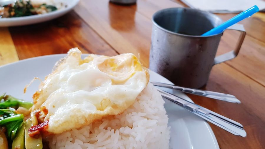Freid egg on rice of Thai dish, kana pla kem Spicy Thai Food Hot And Spicy Menu Healthy Food Thai Food Thai Traditional Food Asian Foods Kana Pla Kem Khana Pla Khem Thai Food Fried Egg Thai Style Comfort Food Quality Plate Table Homemade Close-up Food And Drink Tea Cup