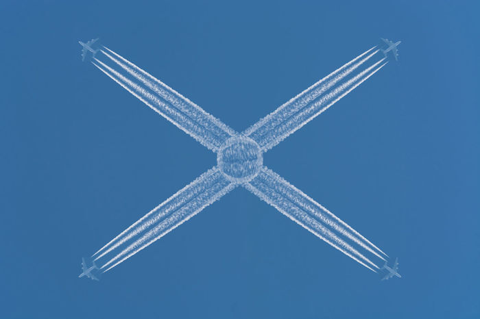 Four planes flying at high altitude. Contrails against a dark blue sky. Airplane Aviation Blue Close-up Contrail Day Flying High Flyer No People Outdoors Pattern Striped Symmetry