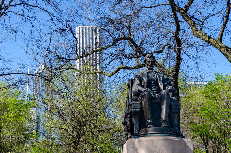 Abraham Lincoln Statue Chicago Architecture Art And Craft Bare Tree Branch Creativity Day Human Representation Low Angle View Male Likeness Memorial Monument Nature No People Outdoors Plant Representation Sculpture Sky Statue Tree
