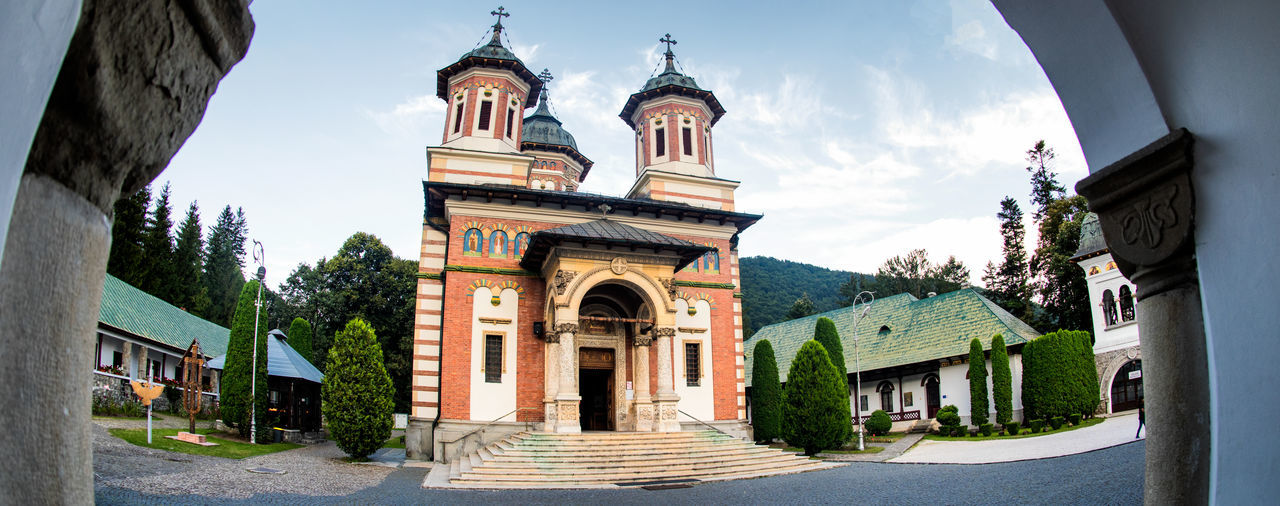 SINAIA Arch Architecture Belief Building Building Exterior Built Structure City Cloud - Sky Day Entrance Façade Nature No People Outdoors Place Of Worship Religion Sky Spire  Spirituality Tower