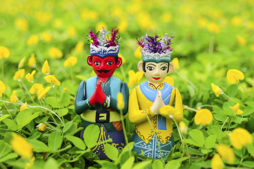 Pumped Up Kicks Puppet Close-up Couple Culture Cultures Day Dog Doll Festival Green Color Jakarta No People Ondel Ondel Outdoors Traditional Welcome To Black Yellow