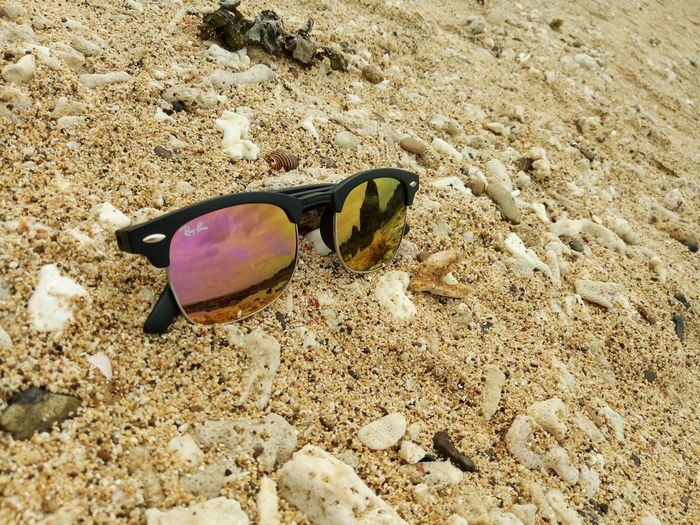 Man made meets God made art Philippine Beach Philippine Beauty Seeing Beyond The Eye! Close-up Outdoors Beauty In Nature Pebble Sunglasses Beach Day White Sand The Great Outdoors - 2017 EyeEm Awards The Photojournalist - 2017 EyeEm Awards Rayban Water Rock - Object