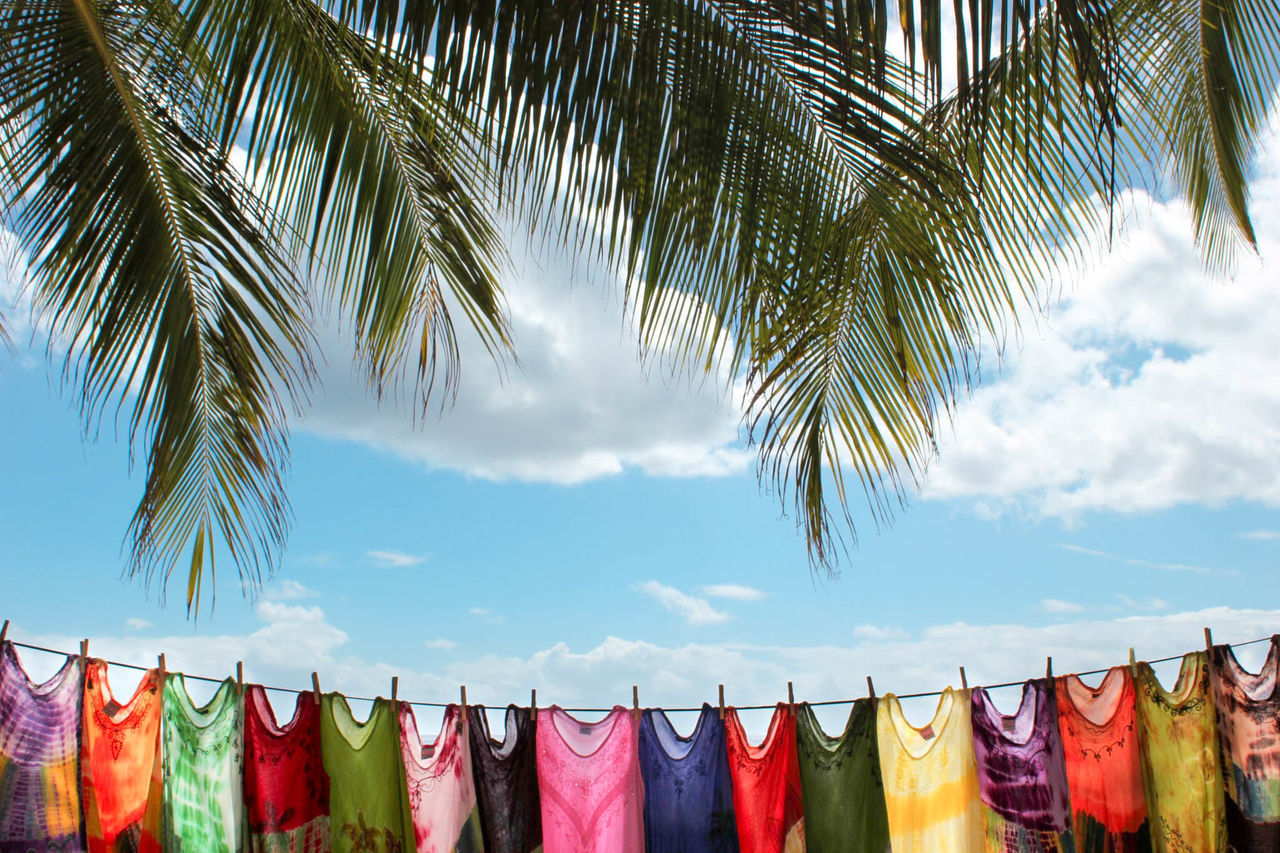 Laundry drying on rope against blue sky