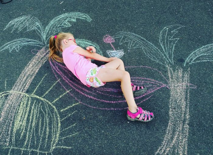 Girl Drawing On Road