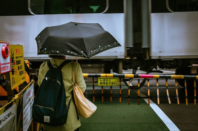Protection Umbrella Wet Security One Person Rain Clothing Real People Safety Lifestyles Women Day