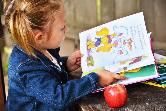 Education Learning Child Creativity Blond Hair Drawing - Activity Childhood Student Leisure Activity Preschool Artist Holding Easel Sitting Lifestyles One Person Girls Human Body Part Boys Women Drseuss The Week On EyeEm