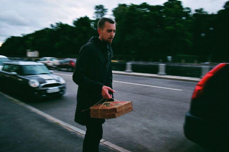 Full length of man on road