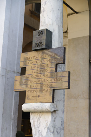Information sign on wall of building