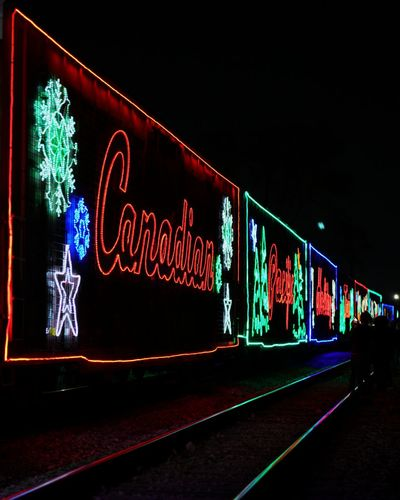 Canadian Pacific Holiday Train Illuminated Multi Colored No People Neon Night Outdoors EyeEm Transportation Detroit, MI EyeEmNewHere Detroitlove EyeEm Selects The Week On EyeEm Trains_r_the_best Train_of_our_world Trains_worldwide Train_nerds Trainspotting Railroad Track Railroad Tracks Railways_of_our_world Light Reflection