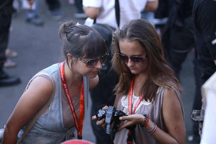 Young women photographing in city