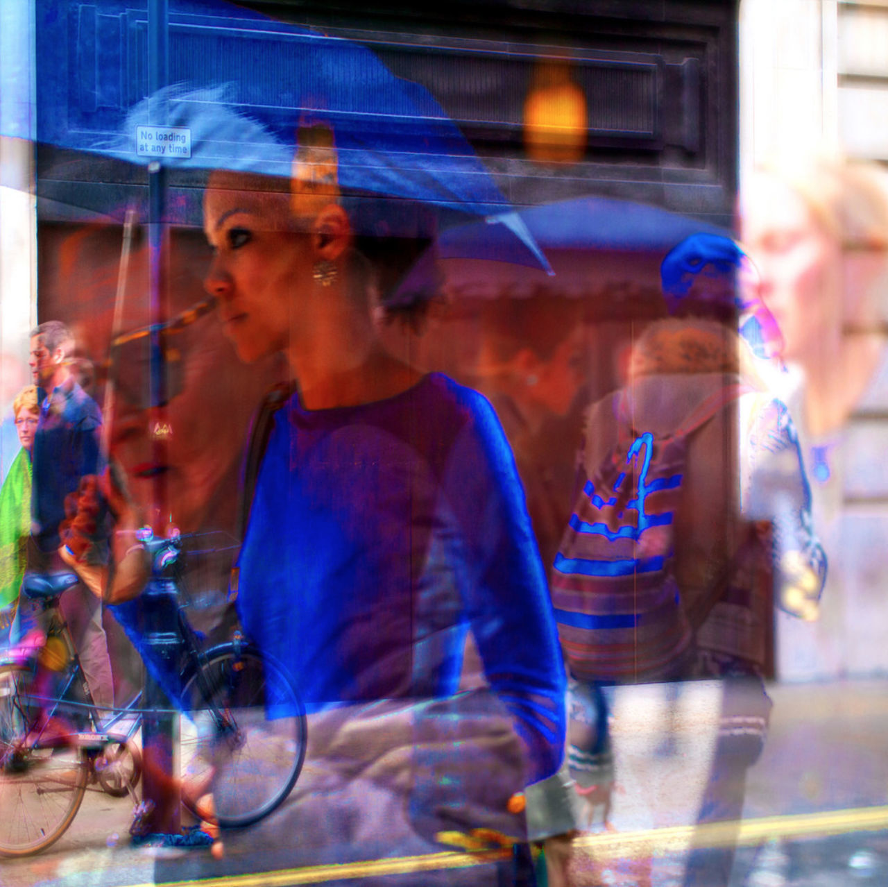 real people, blurred motion, city life, leisure activity, lifestyles, city, men, enjoyment, outdoors, motion, day, large group of people, holding, blue, crowd, young adult, adult, people, adults only