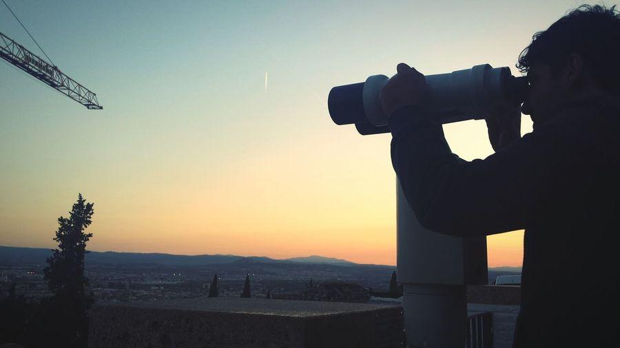 Man working at sunset