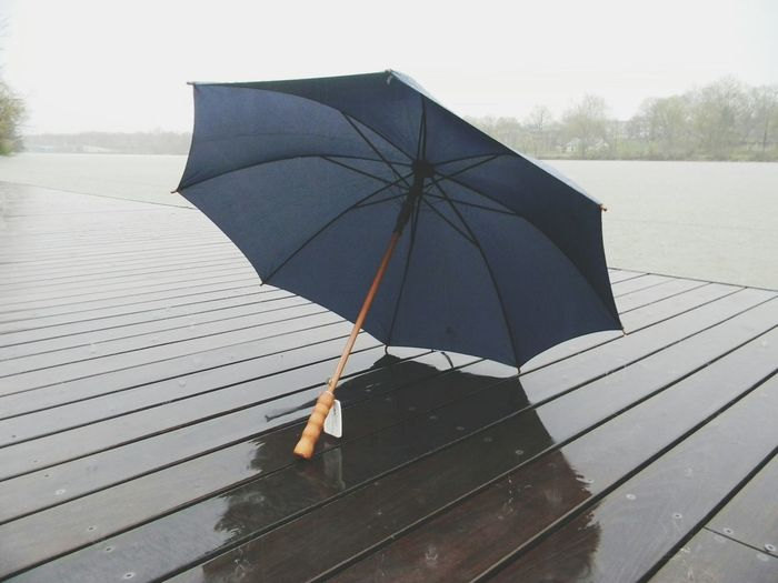 Umbrella on wet deck