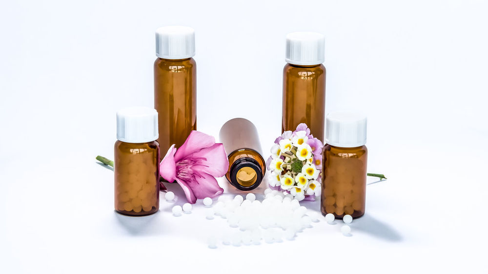 Bottle Clear Closeup Cure Drug Flowers Green Homeopathic Homeopathy Leaves Liquid Macro Medical Medication Medicine Natural Pharmaceutical Pill Remedy Sickness Substance Therapy Treatment White