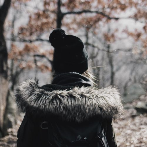 Winter Warm Clothing Focus On Foreground Real People Rear View Cold Temperature Outdoors Fur Glove Snow One Person Day Black Color Lifestyles Men Knit Hat Tree Close-up Wearing Mammal