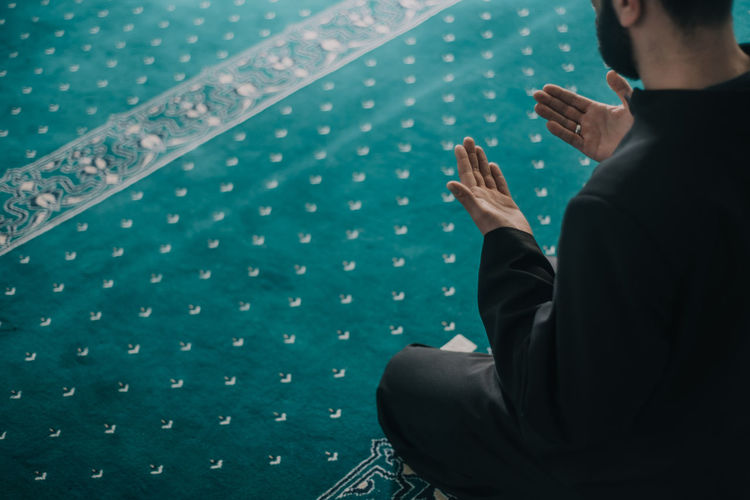High angle view man praying in mosque