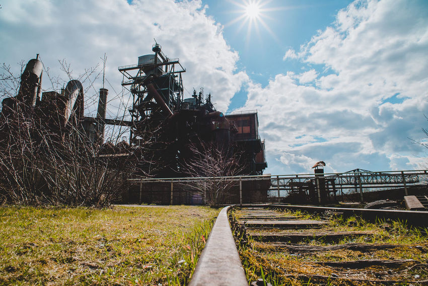 Landschaftspark Nord Abandoned Architecture Built Structure Cloud - Sky Day Field Land Metal Nature No People Outdoors Plant Rail Transportation Railroad Track Sky Sunlight The Way Forward Track Transportation Tree