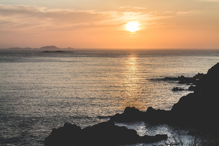 Sunset from the edge of Wales. Beauty In Nature Calm Horizon Over Water Landscape Majestic Nature Photography No People Ocean Outdoors Remote Rock Formation Sea Seascape Sky Sunset Tranquil Scene Tranquility Traveling Water Your Ticket To Europe An Eye For Travel A New Beginning British Culture