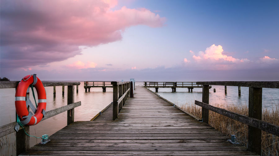 Beauty In Nature Cloud - Sky Day Horizon Over Water Jetty Nature Nautical Vessel No People Outdoors Pier Railing Scenics Sea Sky Sunset The Way Forward Tranquil Scene Tranquility Water Wood - Material Wood Paneling Wooden Post
