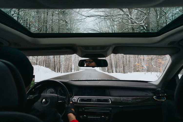 Winter Winter Road Road Road Trip People Real People Man One Man Only One Person Driving Driver Human Hand Men Land Vehicle Car Interior Driving Car Steering Wheel Windshield Speedometer Dashboard Windscreen Car Point Of View Road Trip Vehicle Interior Vehicle Personal Perspective Transparent