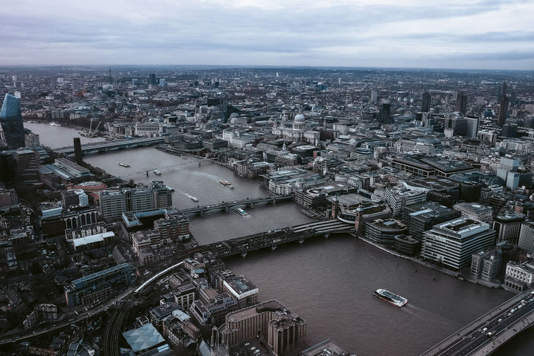 Aerial view of river amidst cityscape