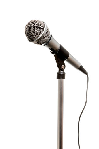 Chrome microphone seen from an angle isolated on a white background Music Industry Arts Culture And Entertainment Chrome Microphone Single Object Speaking Studio Shot Technology White Background