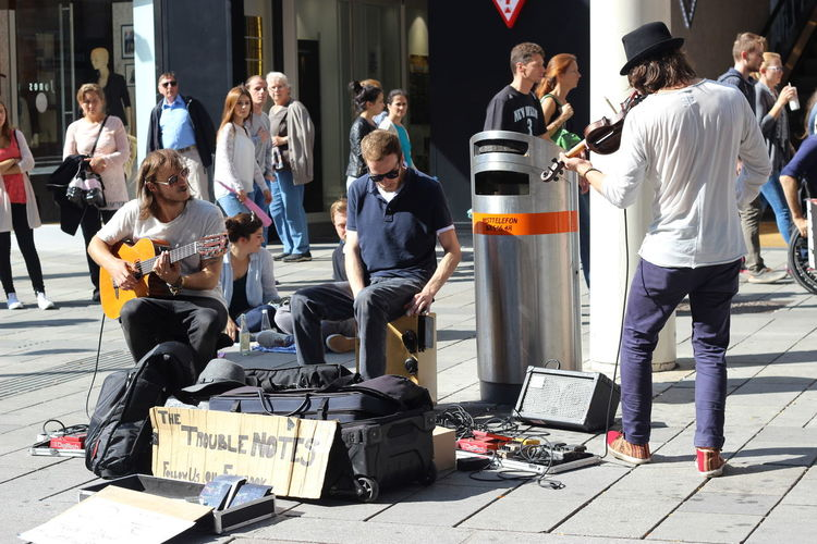 Friends and music Friends Band Street Music Street Musicians Street Life City Life Enjoying Life Making Money Team Street Action Playing Violin Charismatic Music Band Music Brings Us Together