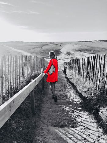 My lady in red❤️ Full Length One Person Water Real People Railing Beauty In Nature Nature Sky Lifestyles Standing Outdoors Tranquility Scenics - Nature Wood - Material Horizon Over Water Day Non-urban Scene Tranquil Scene Rear View Leisure Activity