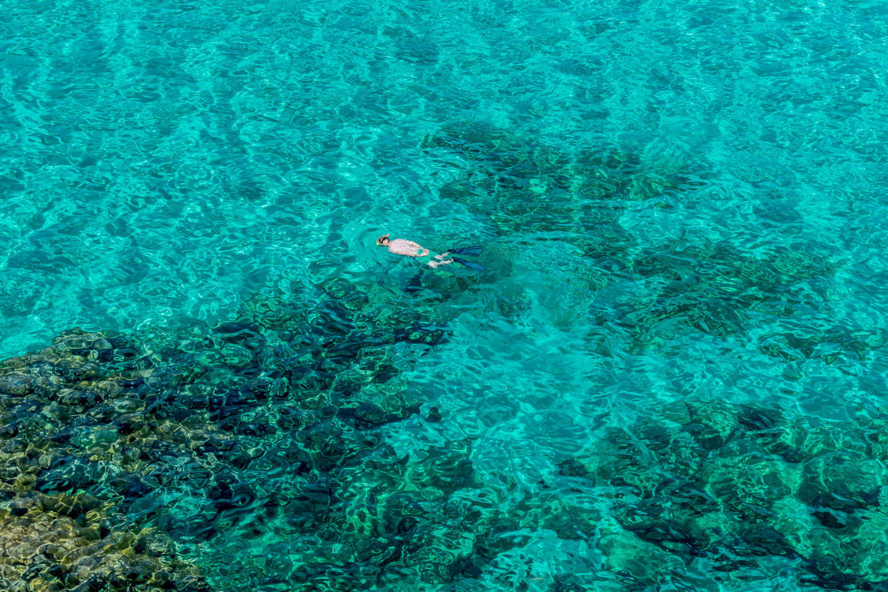 water, sea, swimming, high angle view, one person, underwater, undersea, turquoise colored, leisure activity, nature, lifestyles, sport, beauty in nature, holiday, sea life, trip, vacations, real people, outdoors, snorkeling, marine