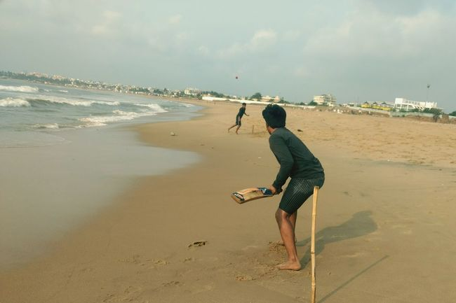 EyeEm Selects Cricket! Vizag Beachphotography Sea Sand Beach Travel Destinations Vacations Playing Sport Nature Water Tranquility Street Cricket Match Shore Sommergefühle Sommergefühle 100 Days Of Summer
