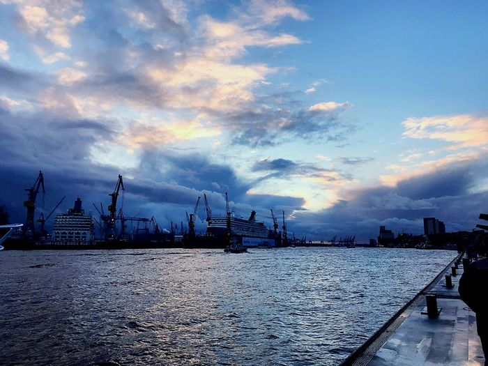 Ferry Cloud - Sky Sky Harbor Sea Pier Water Ship Travel Destinations Crane - Construction Machinery Hamburg Sunset Waterfront Germany