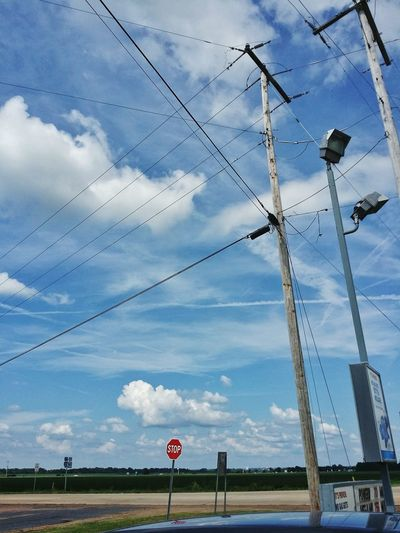 Grid Blue Cloudy Light Pole Stop Sign Road Road Sign Crossing Lines Crossroad Street Countryside Rural Scene Louisiana Road Sign Cable Electricity  Sky Cloud - Sky Power Line  Power Supply Power Cable Wire Electric Pole Telephone Pole