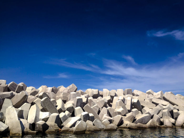 Beauty In Nature Blue Calm Cloud Cloud - Sky Day Majestic Nature No People Non-urban Scene Ocean Outdoors Remote Rippled Rocks Rocks And Water Scenics Sea Shore Sky Solitude Tranquil Scene Tranquility Water Waterfront